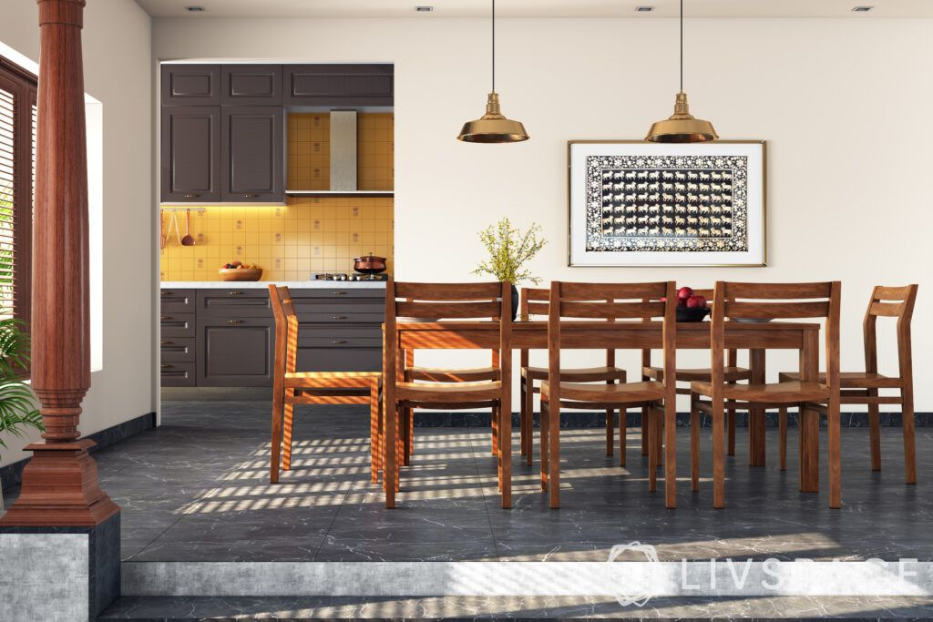 chettinad house-dining table-pillar-brass pendant lights-stone flooring-indoor plants
