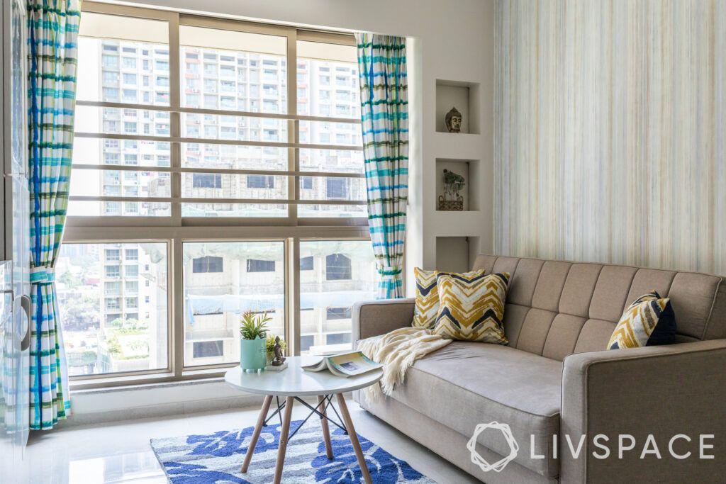 Interior design on a budget-living room-round coffee table-sofa-carpet