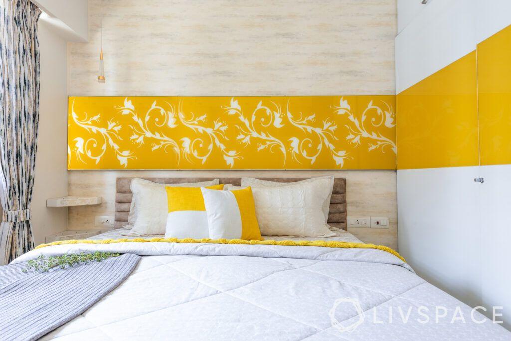 Yellow bedroom-back painted glass panel-wardrobe
