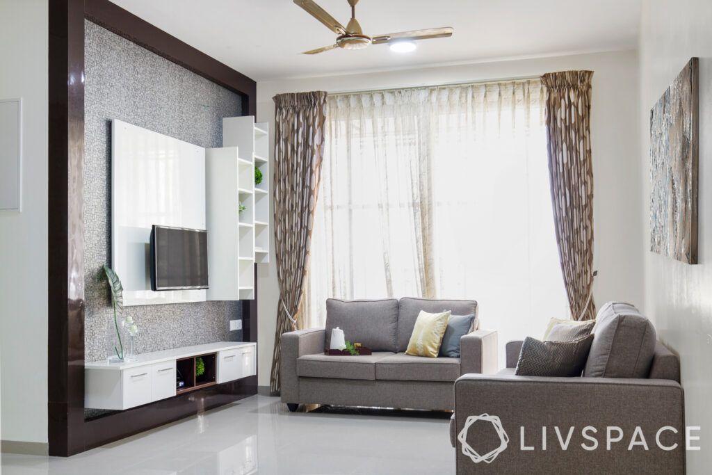 Grey living room-laminate wall panel-tv unit
