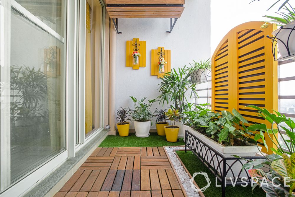 house balcony design-planters-yellow design-wall mounts-wooden ceiling