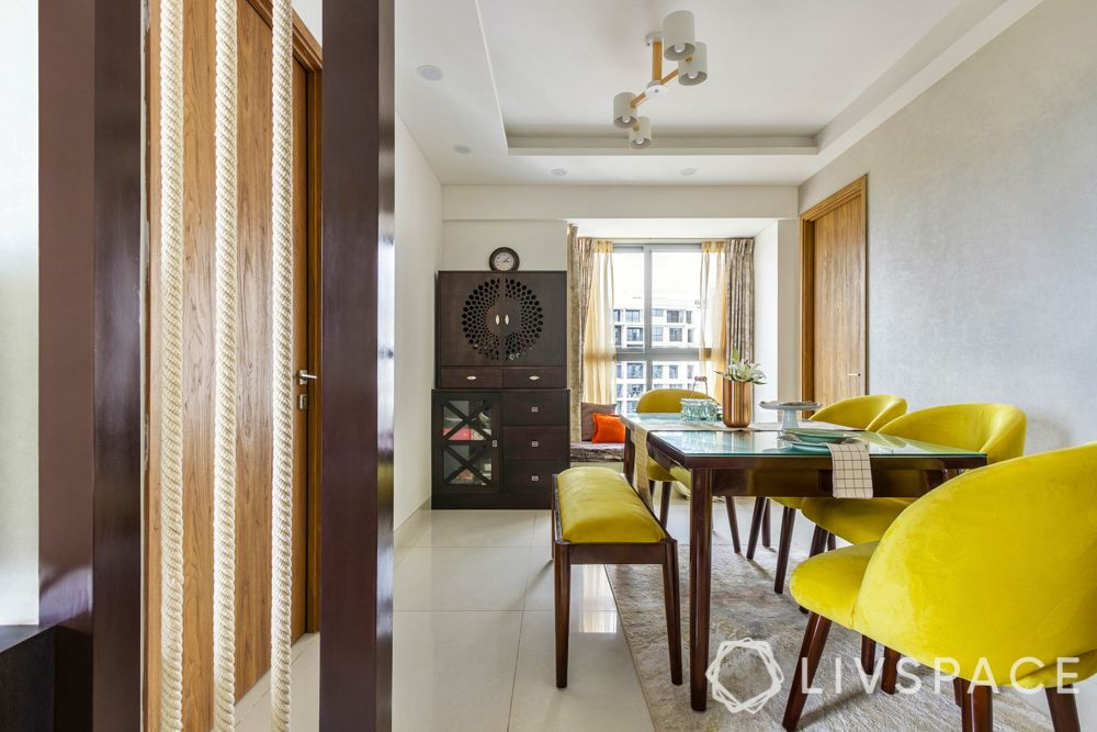 2bhk home design-yellow chairs-dining room-glass top table-rope partition