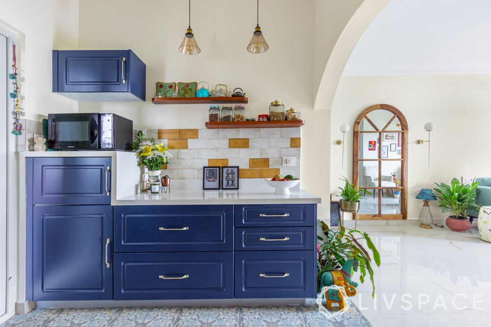These stunning blue membrane finish cabinets are heat resistant