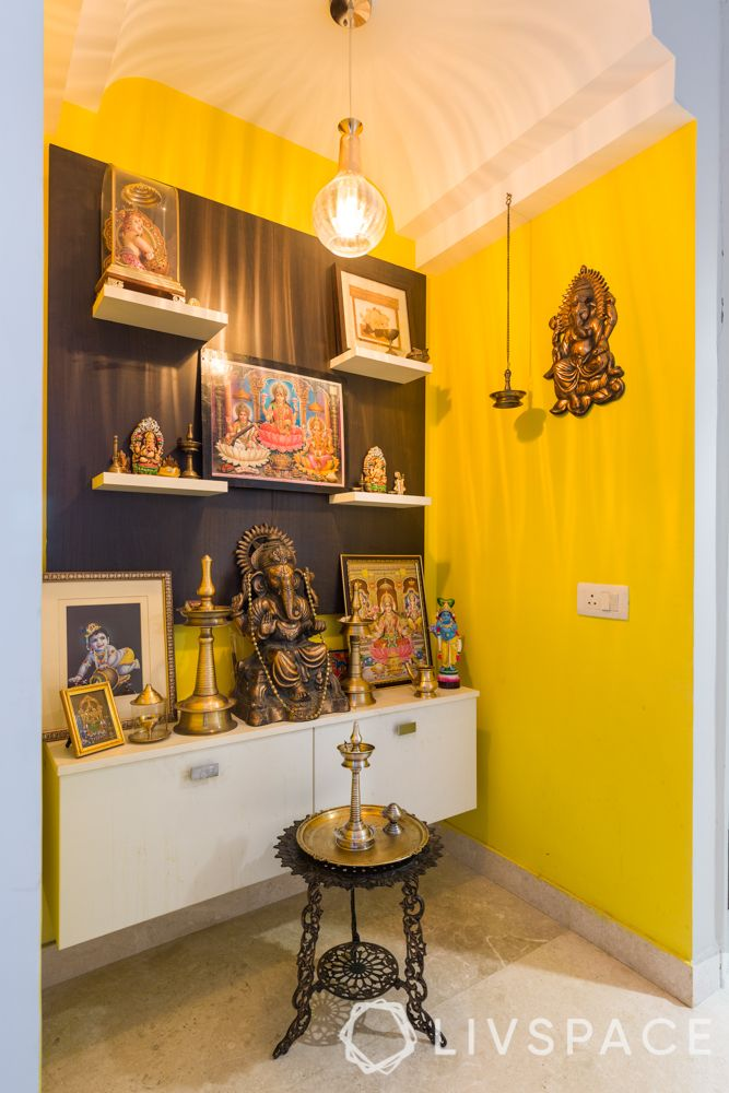 pooja room vastu-yellow wall-lamp