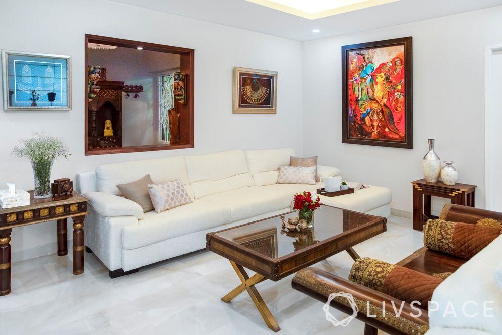 wooden center table-white sofa-artwork-vintage design
