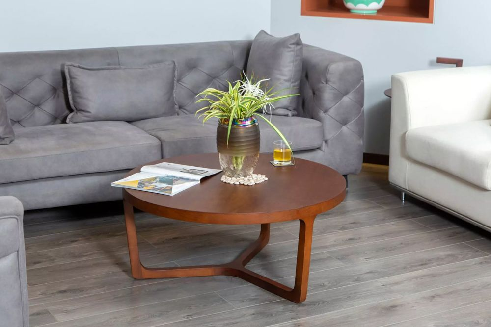 grey sofa-round wooden table