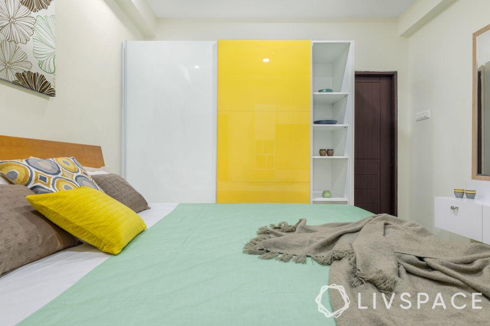 hinged or sliding doors-sliding wardrobe designs-yellow wardrobe designs