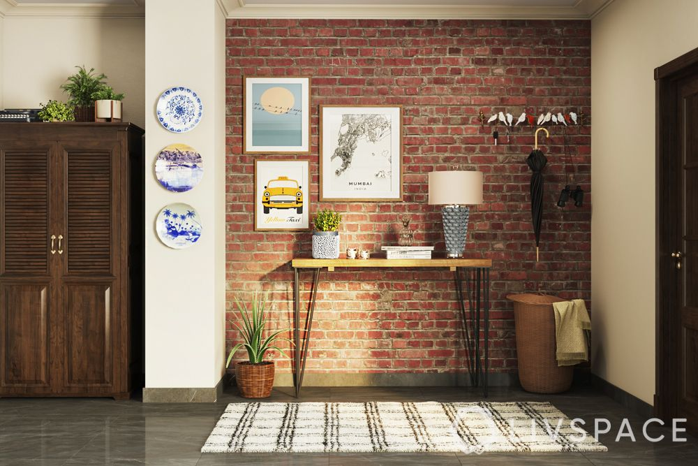 Foyer design-console table-brick wall-plants-wall art
