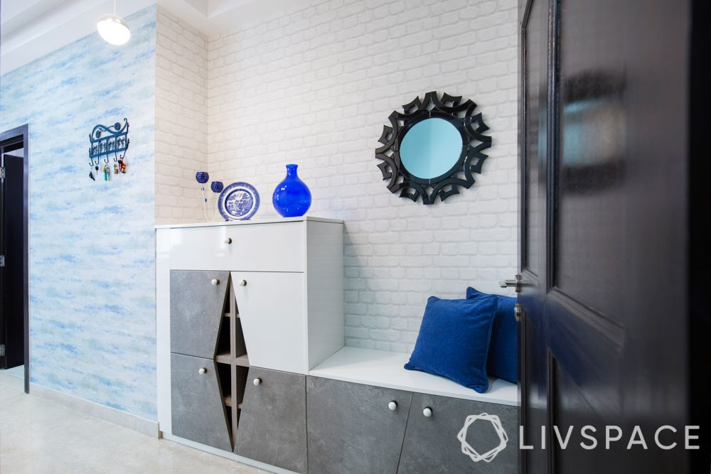 white brick wall-mirror-shoe cabinet