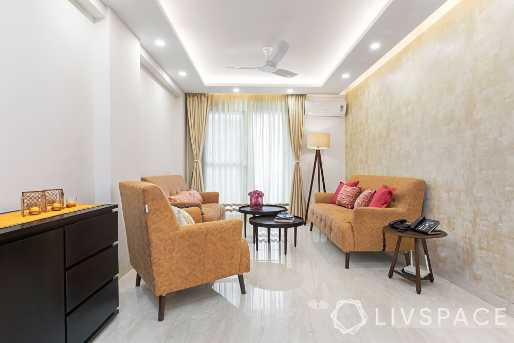 3 bhk design-sofa-wooden drawer-standing lamp-false ceiling-curtains-wooden partitions