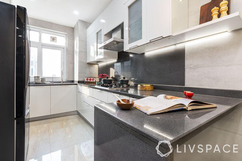 3 bhk design-laminate cabinets-white and grey-L-shaped cabinets-backsplash designs