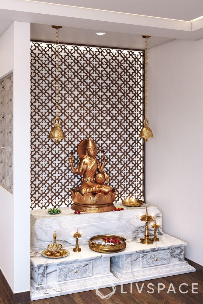 mandir at home-idol-lamps-flowers-bells-jaali backdrop