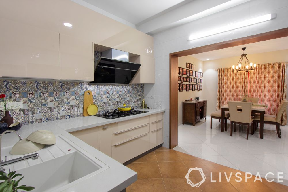 home interiors Bangalore-wooden panelling-light kitchen cabinets-dining table