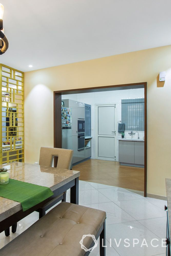 home interiors Bangalore-dining room-kitchen entrance-wood paneling
