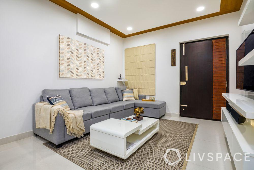 false ceiling-wooden laminate ceiling-L-shaped sofa-jhoola-tv uni