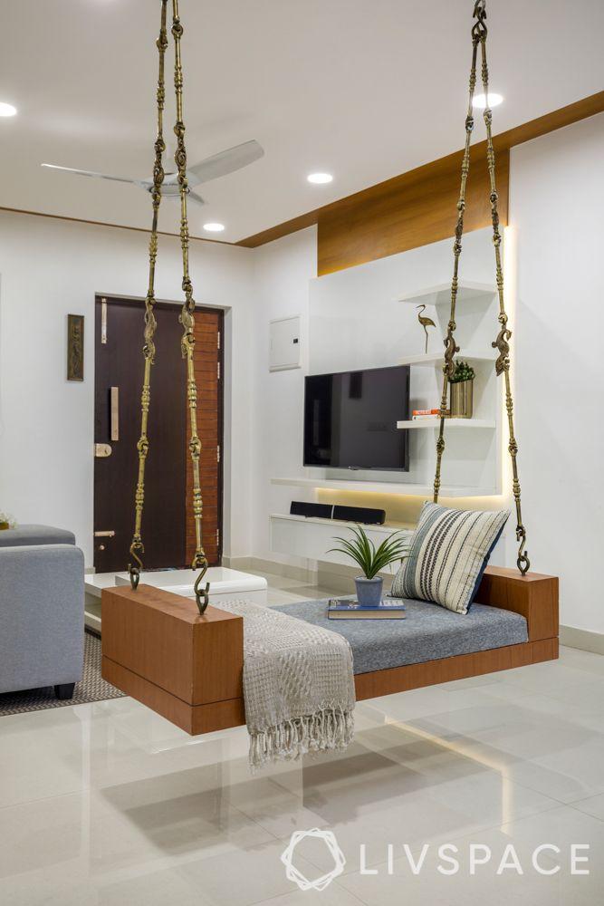 false ceiling-wooden laminate ceiling-L-shaped sofa-jhoola-tv unit