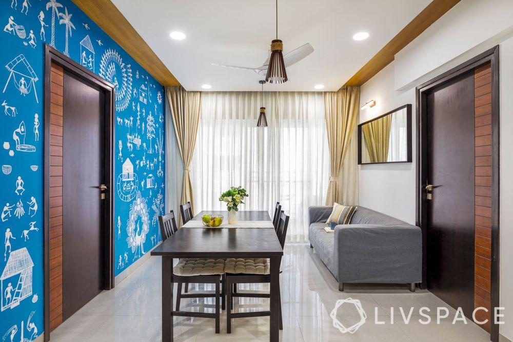 pendant lights-mirror-sofa-warli artwork-false ceiling design
