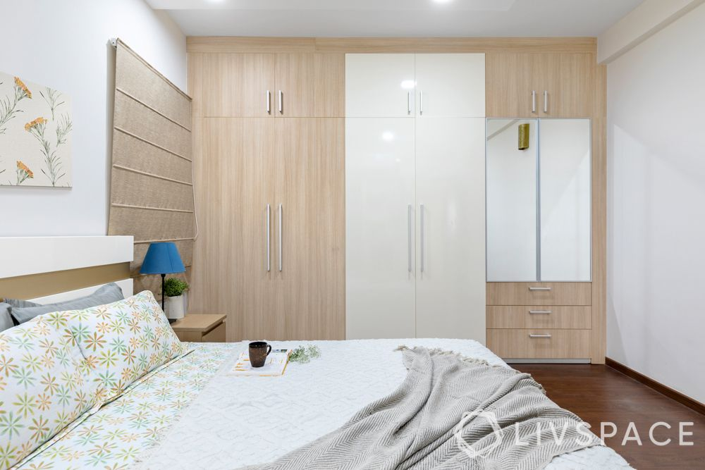 light wood wardrobes-white and brown room-dark wooden flooring-end to end wardrobes