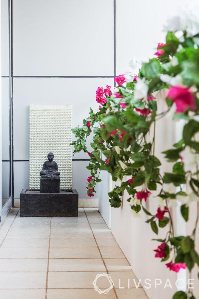 Balcony-buddha statue-creepers