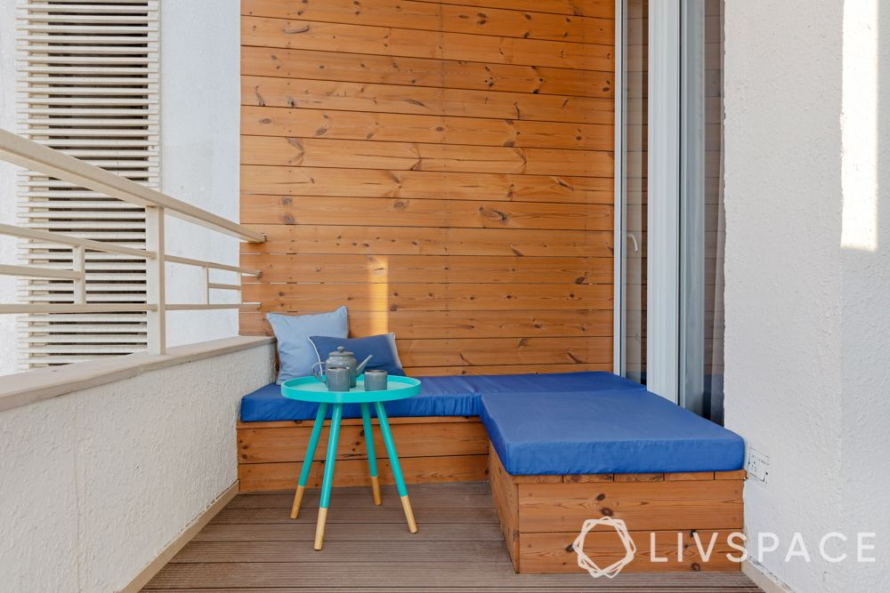 Balcony-table-cushioned seating-wooden panelling