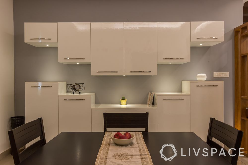 dining room storage idea-white acrylic cabinets, crockery cabinet