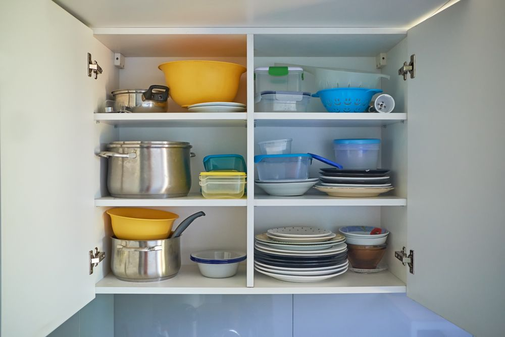 kitchen wall cabinets-stacked up utensils