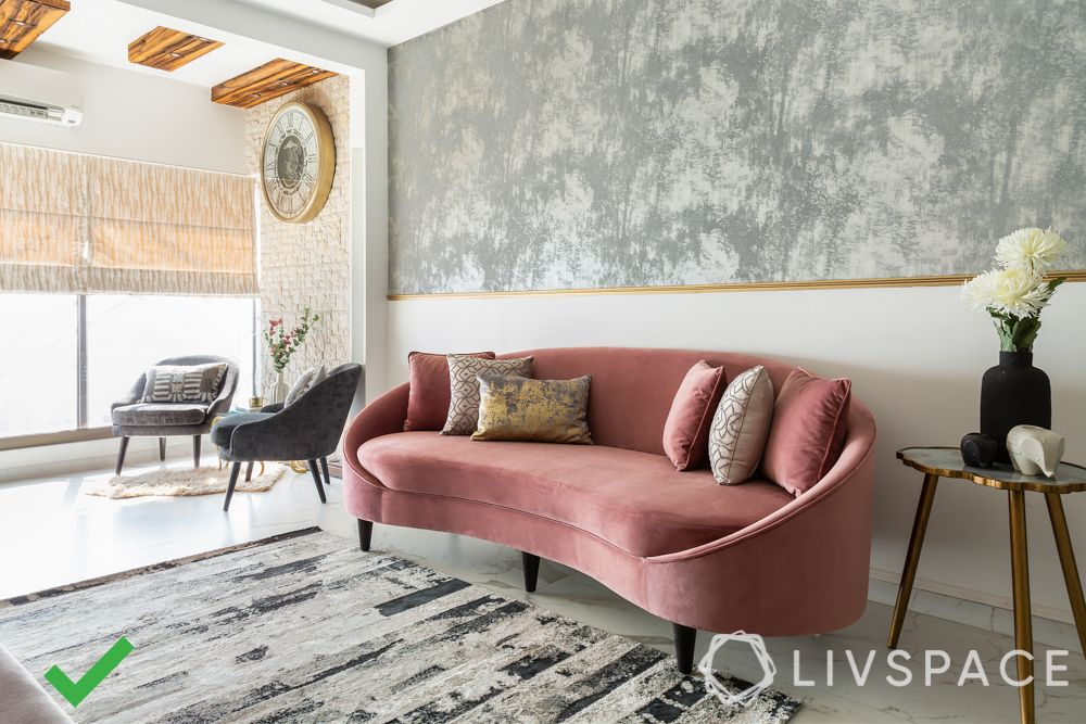 bad interior design example-rounded sofa-grey wall