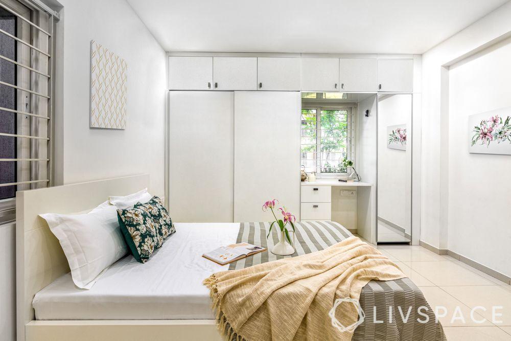 hyderabad interiors-white bed-white walls-white wardrobe-loft space-sliding wardrobes