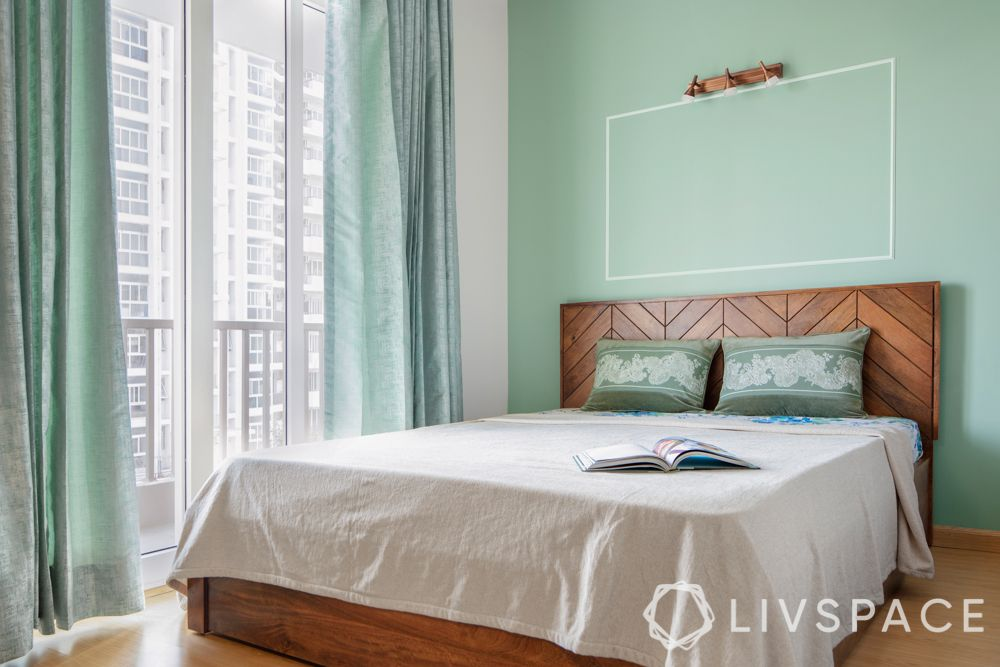green accent wall-wooden bed