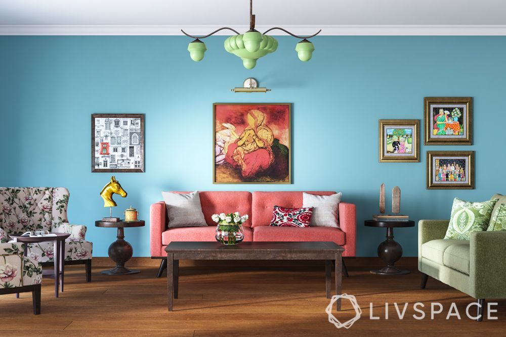 living-powder blue wall-coral couch-beige sofa-printed wingback chair-green lamp