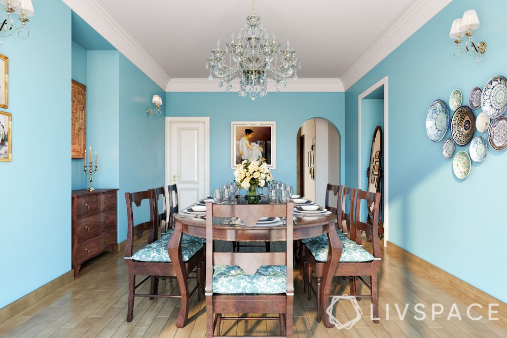 boman irani-dining-powder blue walls-chandelier-wooden furniture