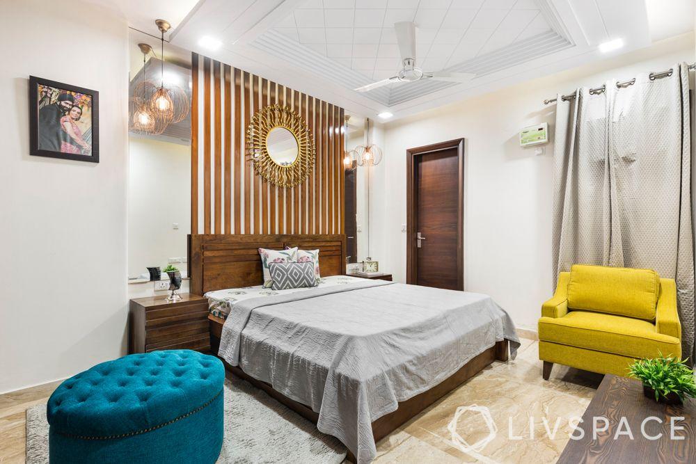 pop designs-inverted cove false ceiling-yellow sofa