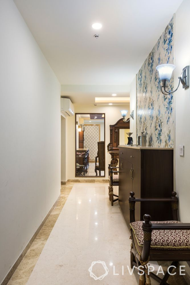 foyer furniture-marble flooring-floral wallpaper