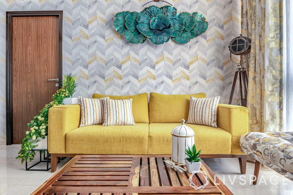 interior design for 2bhk flat-yellow sofa-chevron wallpaper