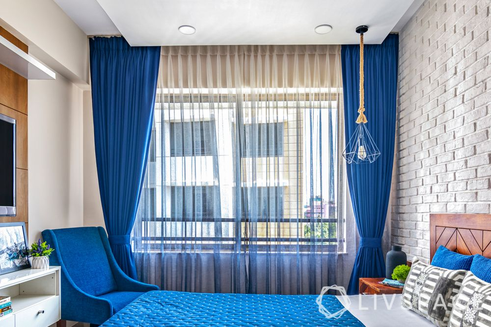 blue accent chair-blue curtains-sheer curtains