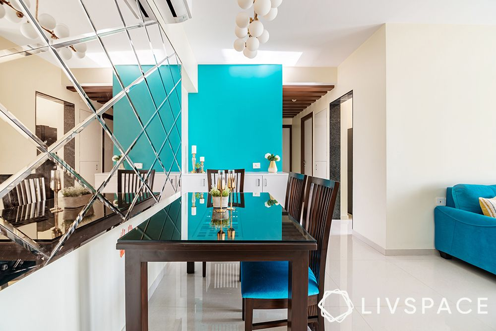 Wooden dining table set-blue wall-mirror wall-pop false ceiling-foyer