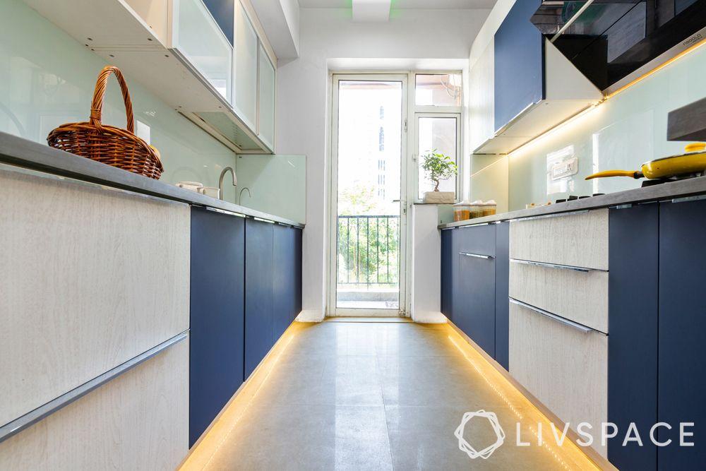 vitrified tiles vs marble-tile flooring-blue and white kitchen