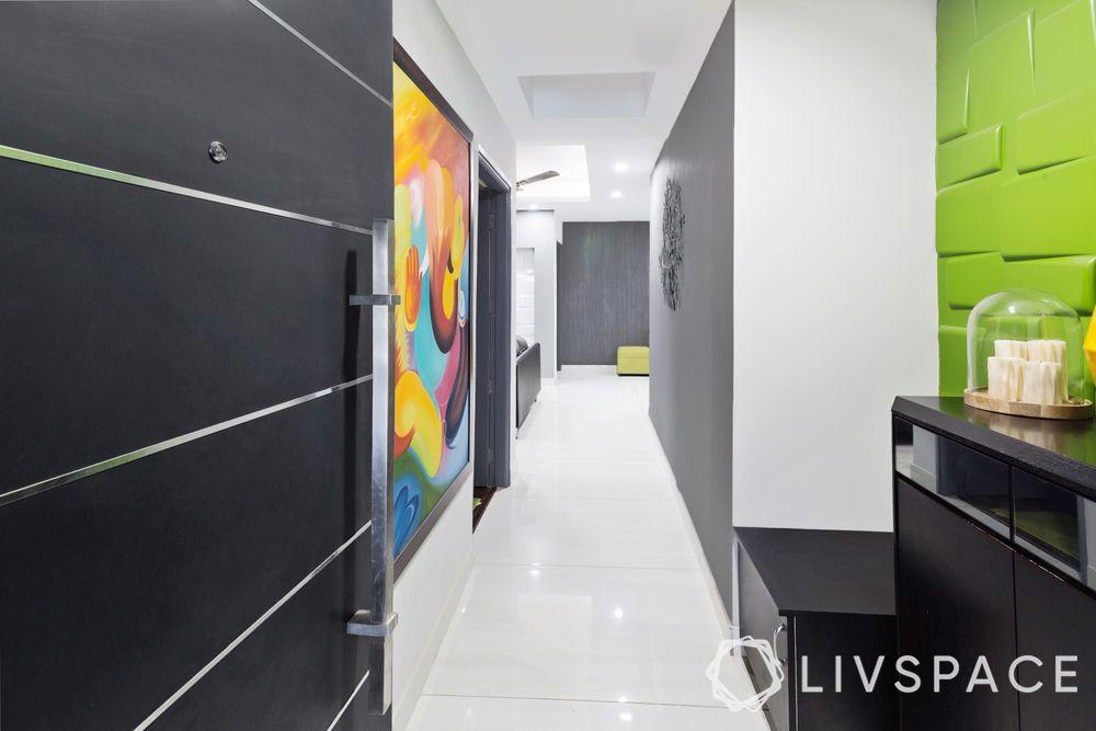 vitrified tiles vs marble-foyer-white tiles-green wall treatment