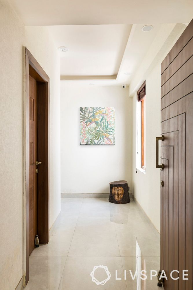 beautiful-houses-photos-foyer-white-wall-false-ceiling-tree-trunk