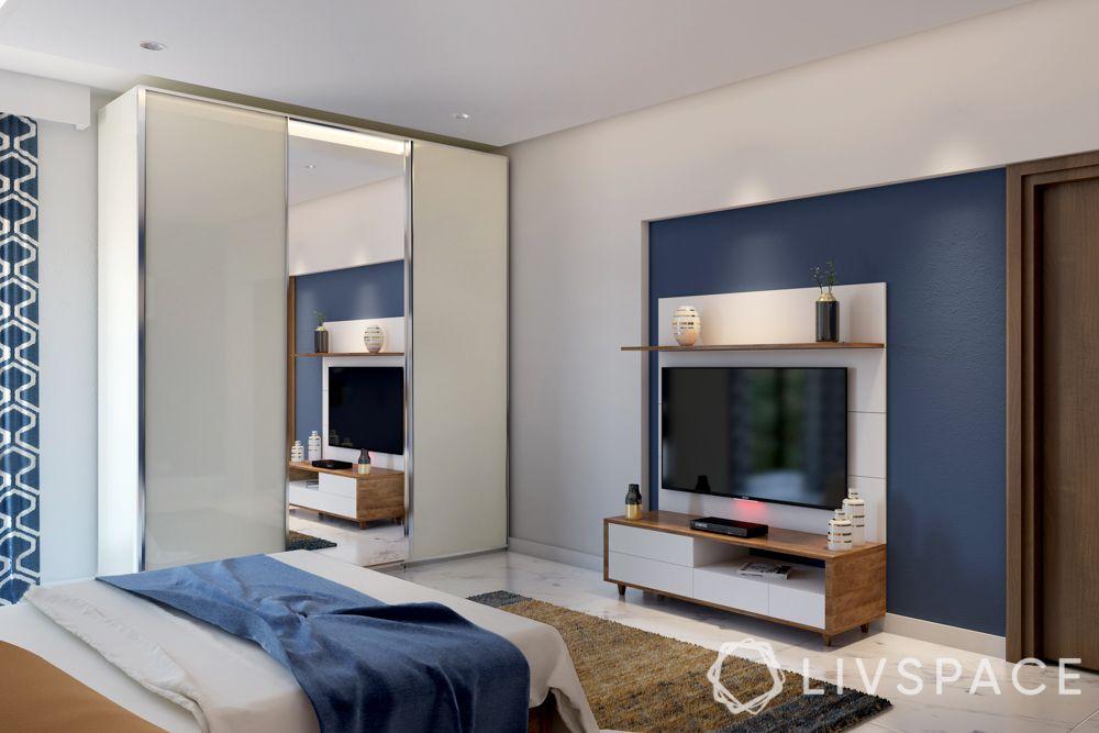 mirror-cupboard-blue-wall-tv-bedroom