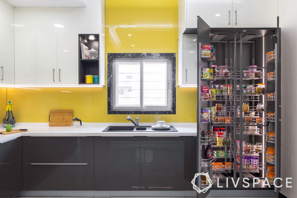 indian style kitchen design-tall cabinet-pantry pull out-yellow glass back panel
