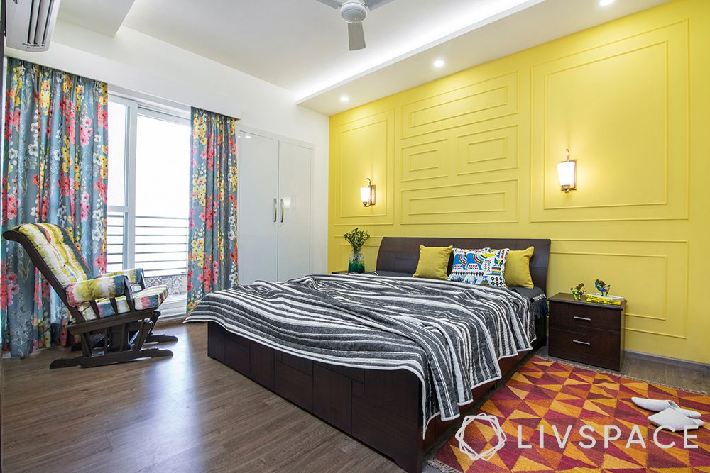 vastu-colours-for-bedroom-yellow-armchair-rug