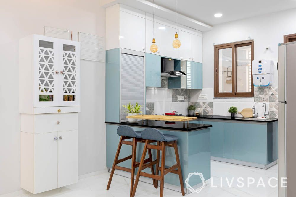home-interiors-hyderabad-blue-kitchen-breakfast-counter