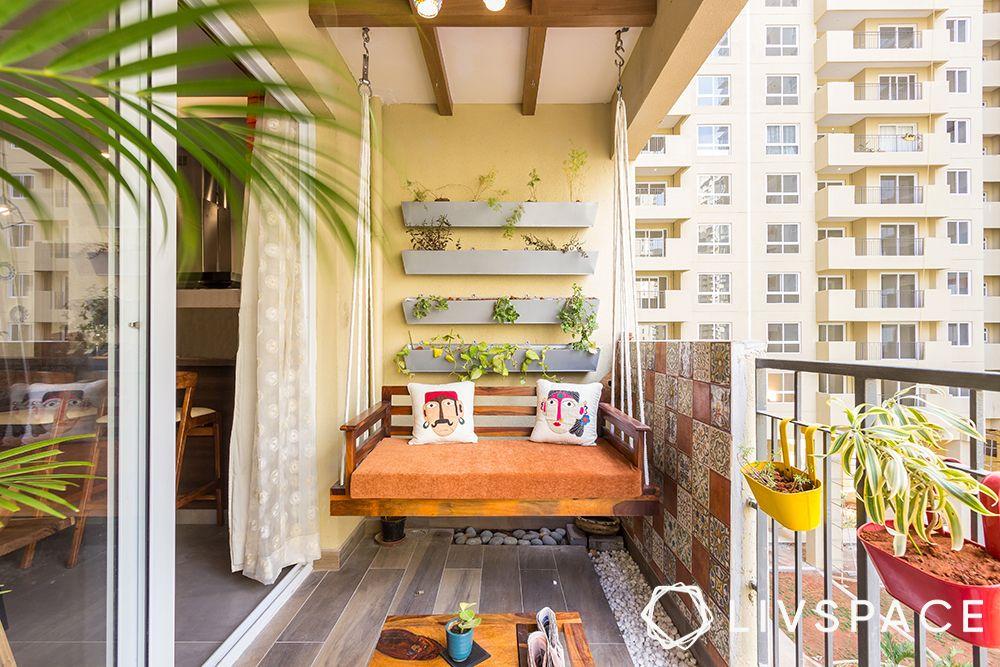 small-balcony-ideas-planter-wall-swing-pebble-bank