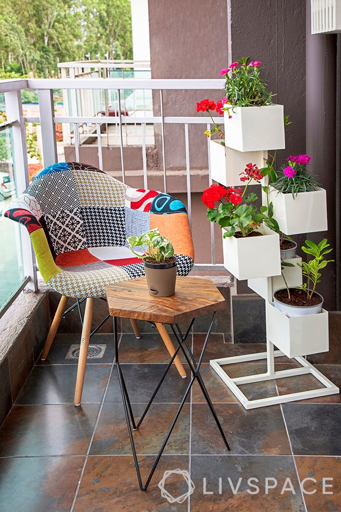 small-balcony-ideas-white-planters-patchwork-chair-flowers