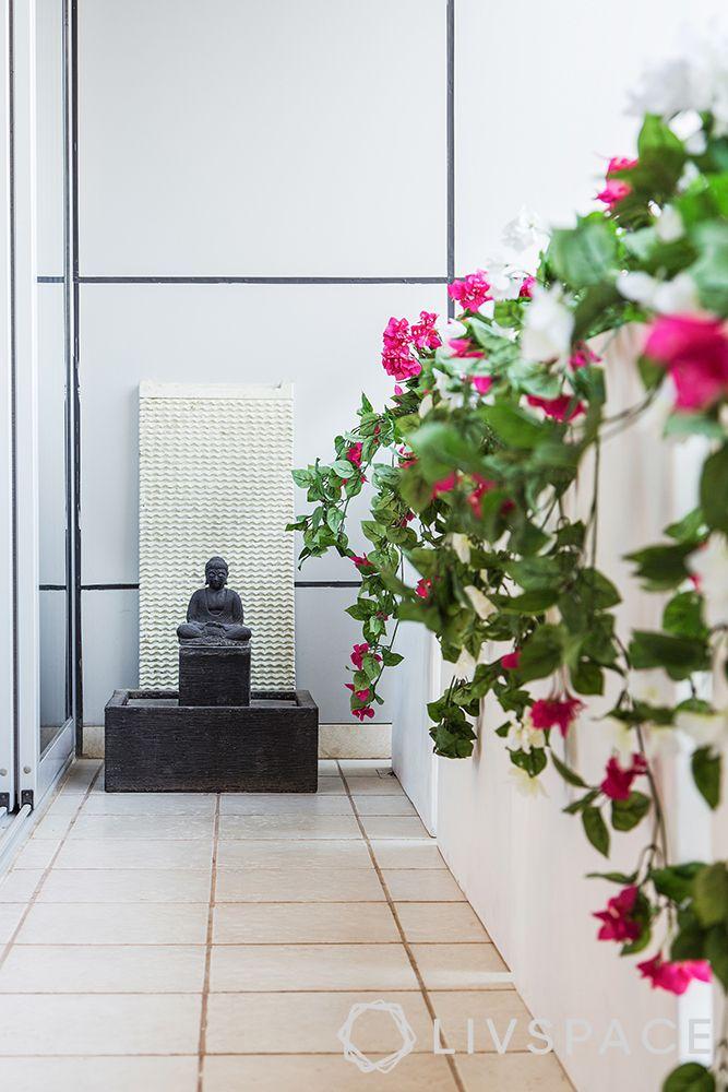 small-balcony-ideas-zen-buddha-white-wall-flowers