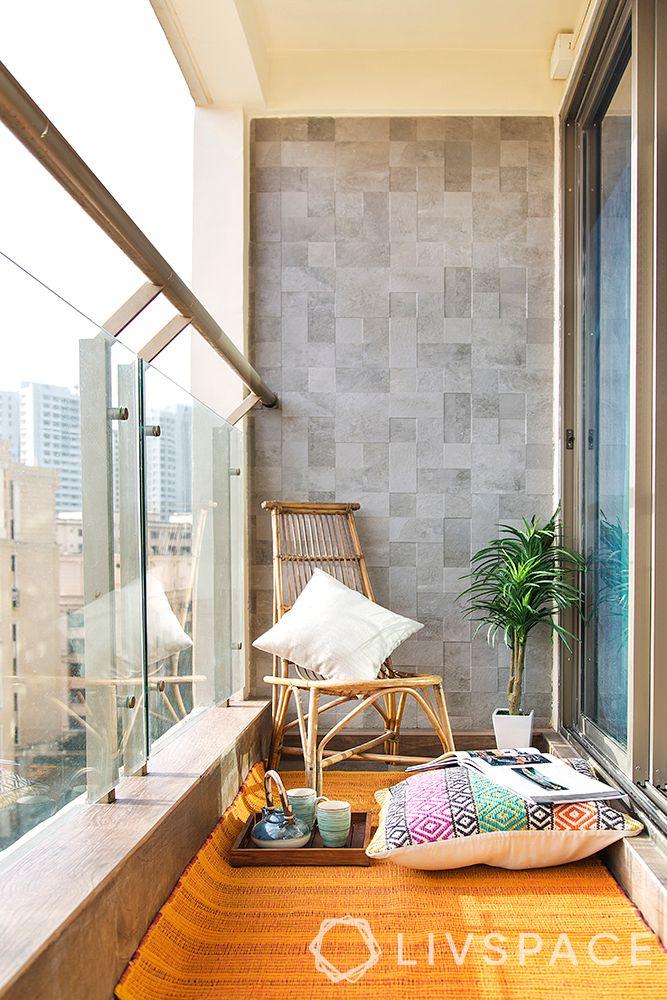 tiny-balcony-glass-railing-floor-pillow