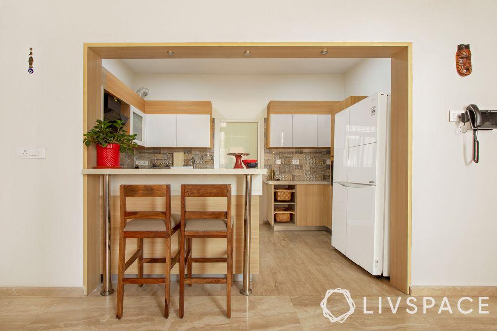 villa interiors-open kitchen-acrylic finish cabinets