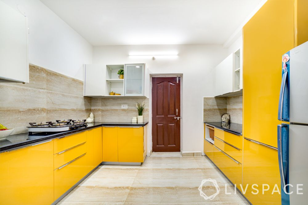 hyderabad interior designer-yellow kitchen-membrane finish cabinets