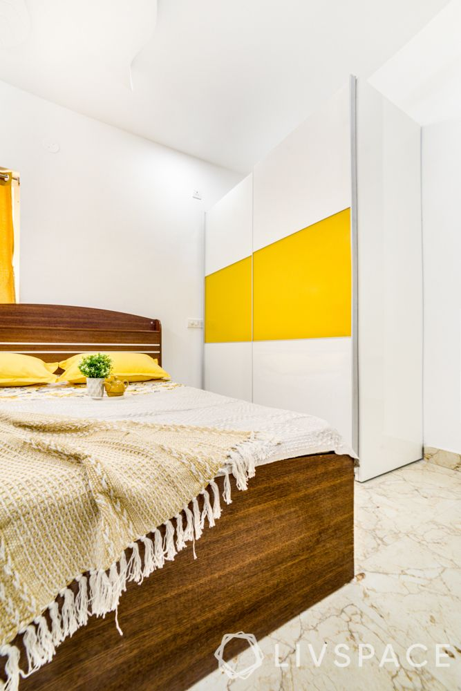 hyderabad interior designer-yellow wardrobe-sliding wardrobe